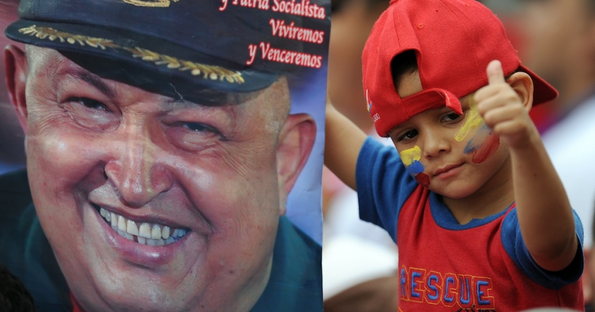 #172 — Venezuela<br /> A boy gives a thumbs up as he holds a poster of Venezuelan President Hugo Chavez during a ceremony to celebrate the Day of the Student at the presidential palace Miraflores in Caracas on Nov. 21, 2011.</p>