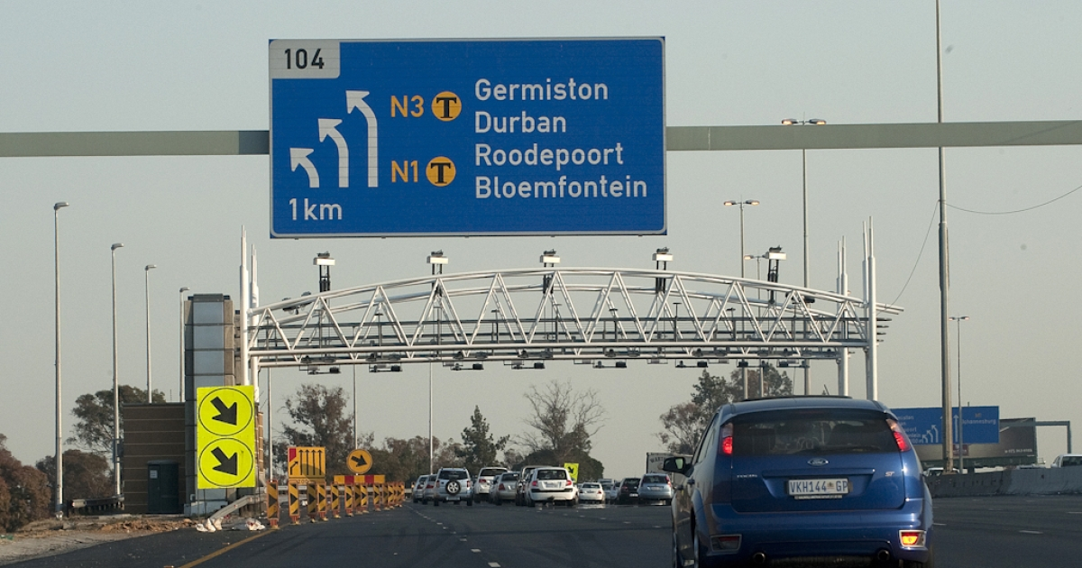 South African motorists drive towads the new electronic toll plaza on the highway from Pretoria to Johannesburg. As years of construction on Johannesburg's main highways winds down, electronic toll plazas have sprung up, to an outcry among drivers at the rates they'll be charged.</p>