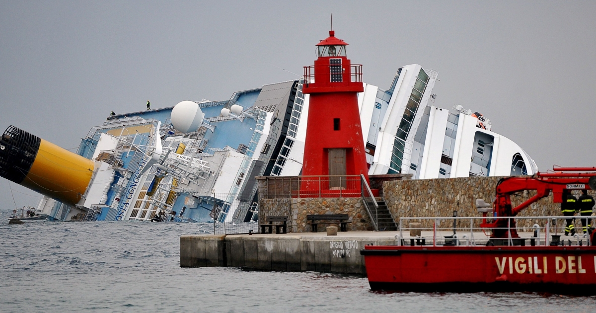 Firemen patrol the area near the Costa Concordia cruise ship in the harbor of the Tuscan island of Giglio. At least 17 people died when the ship struck rocks and keeled over onto its side as it carried out a traditional salute to islanders last month. Fifteen people remain unaccounted for.</p>