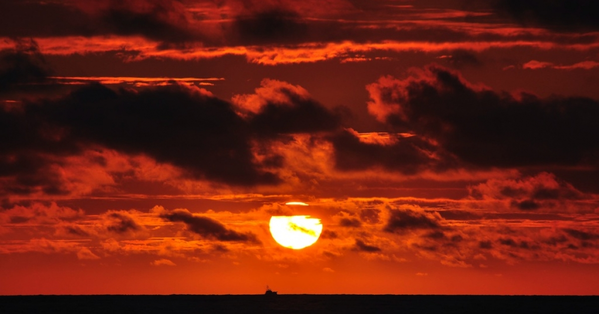A boat is seen at sunset at the Pacific Coast in front of Jaco Beach in Costa Rica on December 5, 2010.</p>