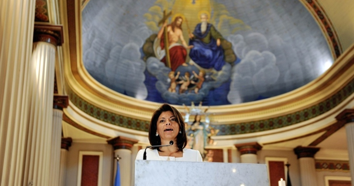 Church and state: Costa Rican President Laura Chinchilla speaks during mass at the main Cathedral in San Jose. In deeply Catholic Costa Rica, the Supreme Court banned in-vitro fertilization.</p>