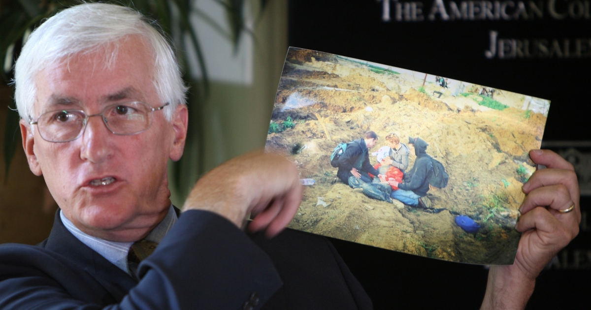 Craig Corrie displays a picture from the site Rachel was killed.</p>