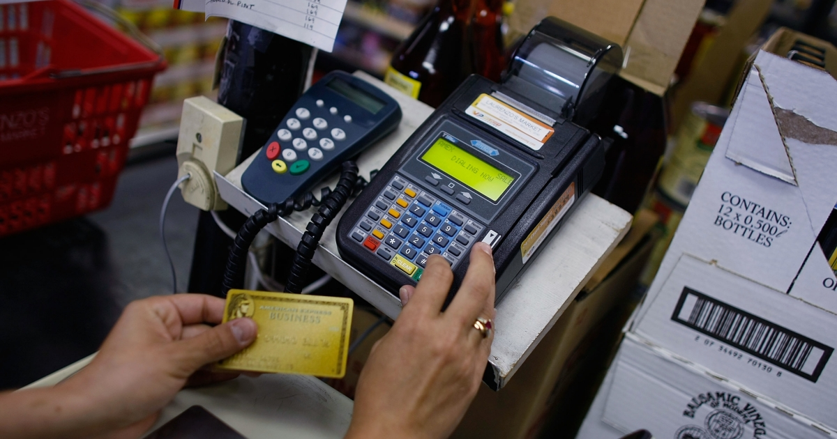 A credit card reader is used to charge a credit card from a customer at Lorenzo's Italian Market in Miami, Fla.</p>