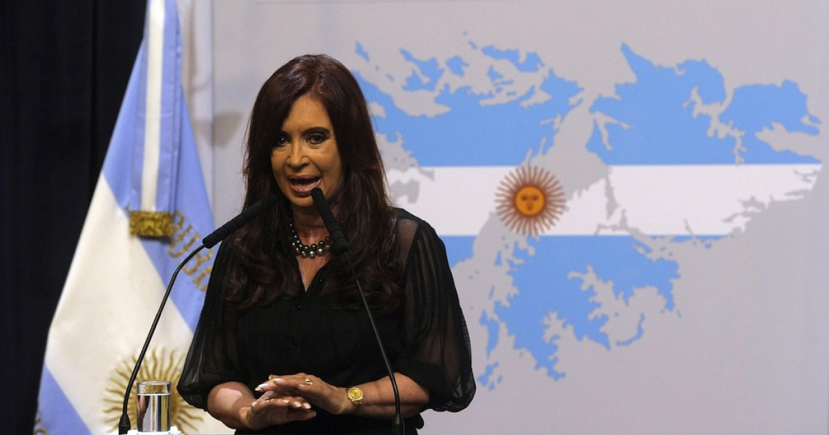 Argentine President Cristina Fernandez de Kirchner delivers a speech in front of a backdrop displaying the Falkland Islands (Malvinas in Spanish) painted like the Argentine national flag at Government Palace in Buenos Aires on February 7, 2012.</p>