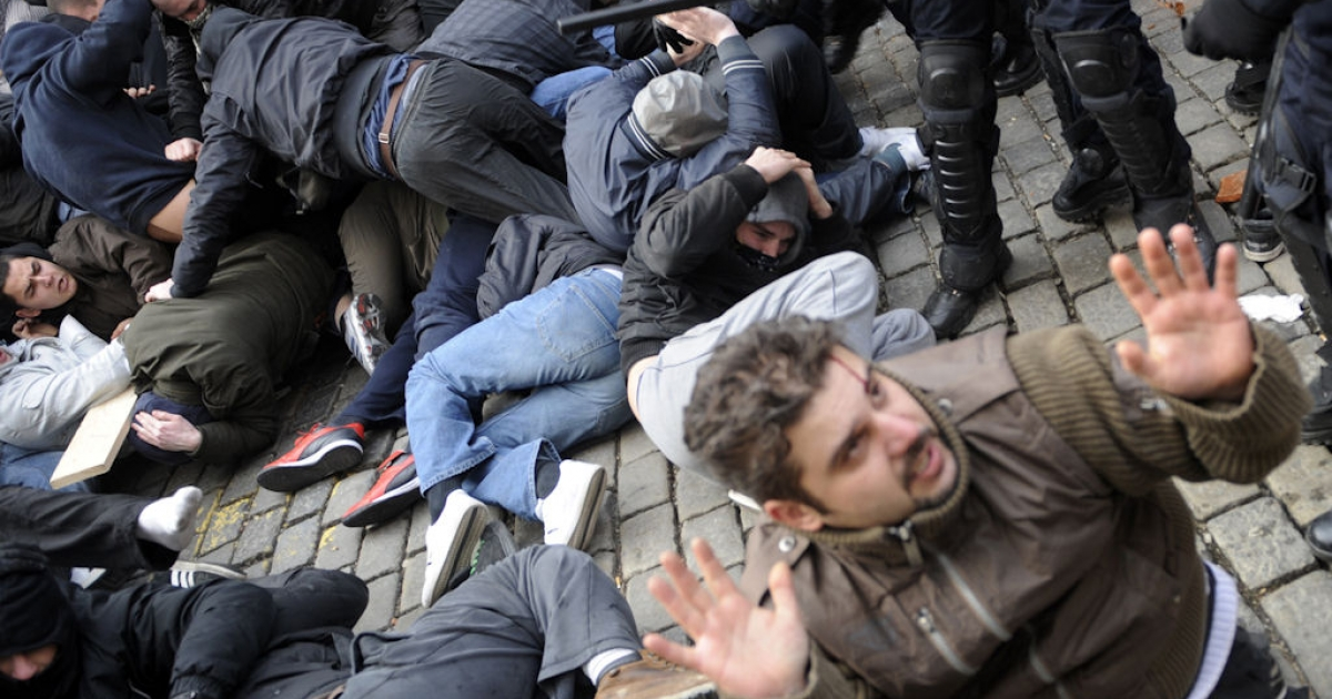 Policemen clash with protesters during a demonstration in Zagreb on Feb. 26, 2011. Hundreds of anti-government protesters clashed with police leaving 33 people injured while several dozen were detained.</p>