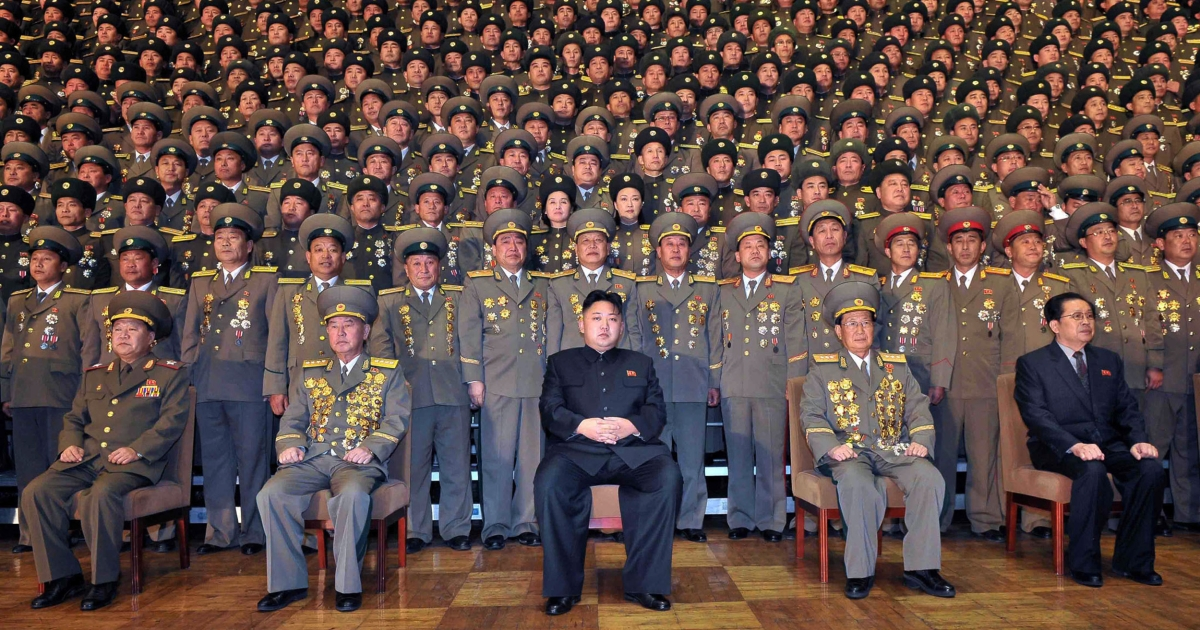 North Korean leader Kim Jong-Un (C) during a photo session with participants in the national meeting of chiefs an undisclosed location in North Korea on Nov. 27, 2012.</p>