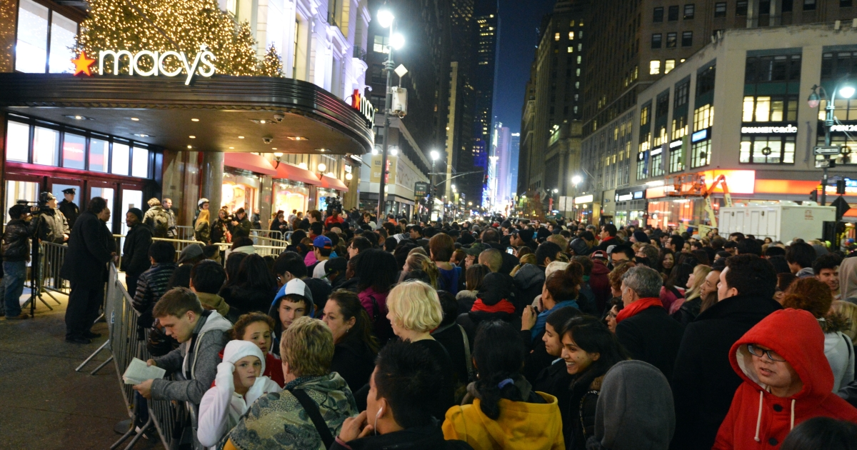 Crowds gather outside Macy's department store before 'Black Friday' shopping weekend on Nov. 22, 2012 in New York City.</p>