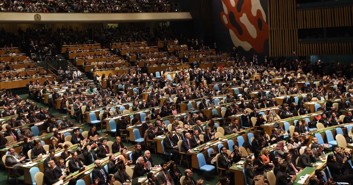 UN General Assembly members applaud after granting 'non-member observer' status to Palestine on Nov. 29, 2012 in New York City.</p>