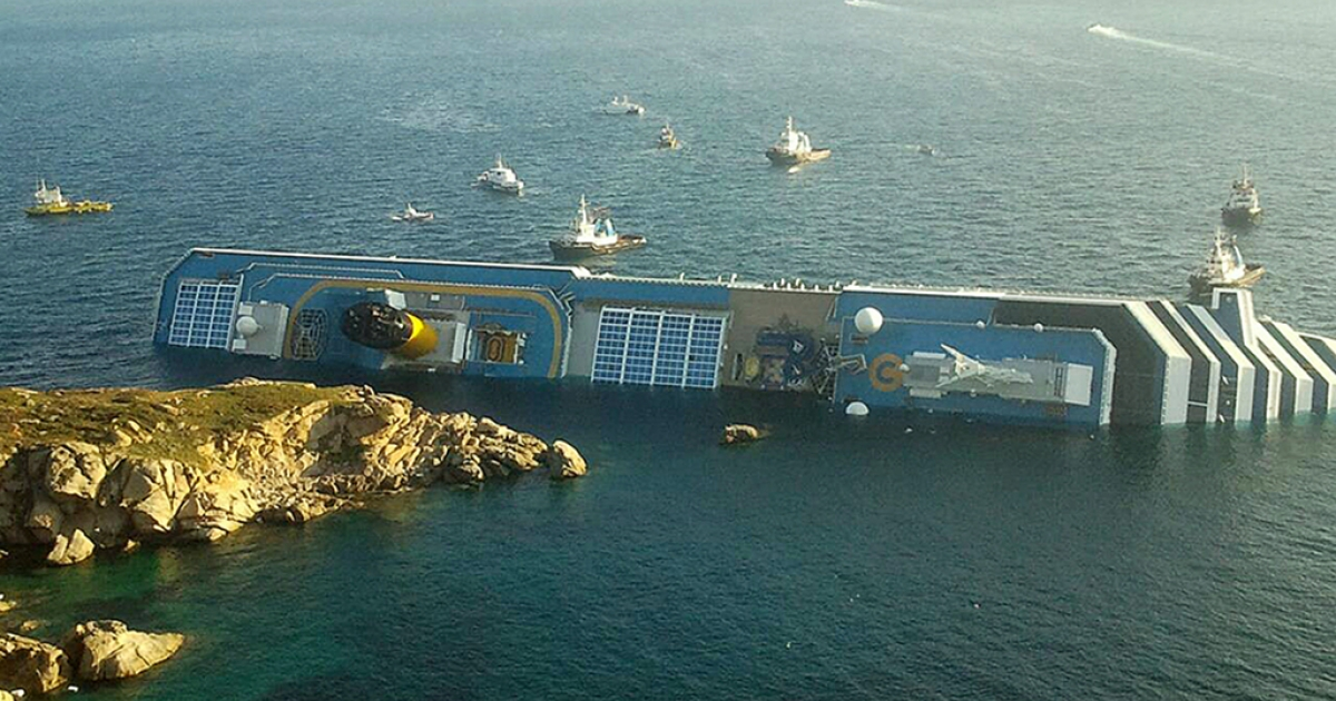 A photograph taken early on January 14, 2012 of the Costa Concordia after the cruise ship with more than 4,000 people on board ran aground and keeled over off the Isola del Giglio, and Italian island, Friday night.</p>