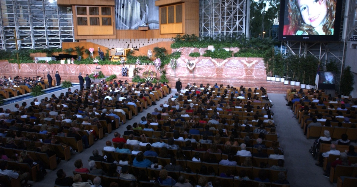 A slide presentation is shown during the funeral for 5 year old Samantha Runnion at the Crystal Cathedral on July 24, 2002 in Garden Grove, California</p>