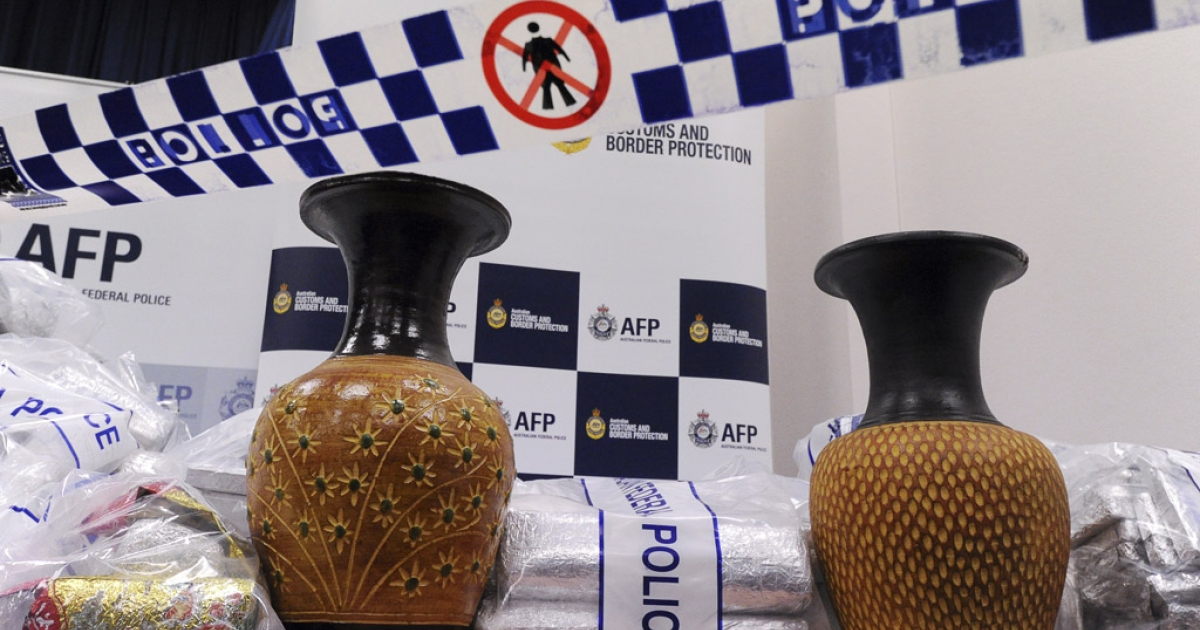 Australian Federal Police (AFP) display ceramic vases used to conceal 525 million USD worth of crystal methamphetamine ('ice') and heroin after smashing a Hong Kong-based international drugs syndicate in Sydney on July 31, 2012. It was the largest haul of ice (306 kilograms) in Australian history and the third-biggest heroin bust (252 kilograms) and was the culmination of an 11-month operation following a tip-off from the US Drug Enforcement Administration.</p>
