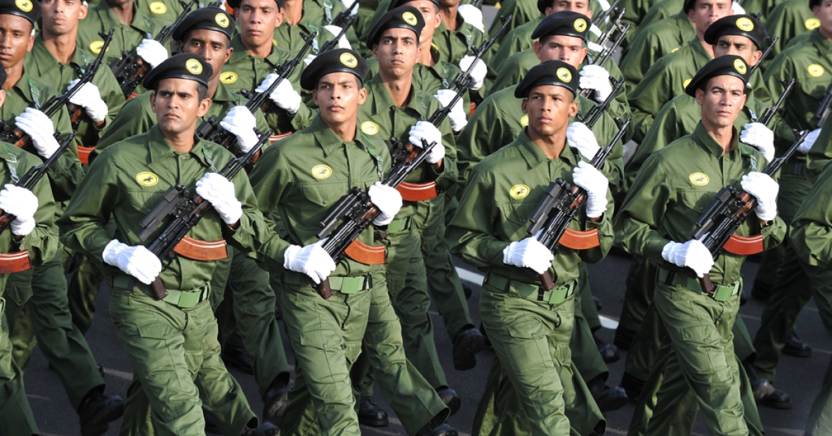 Cuban special forces march, on April 16, 2011 in Havana, during the military parade to commemorate the 50th anniversary of the Bay of Pigs and the beginning of the Cuban Communist Party 6th Congress.</p>