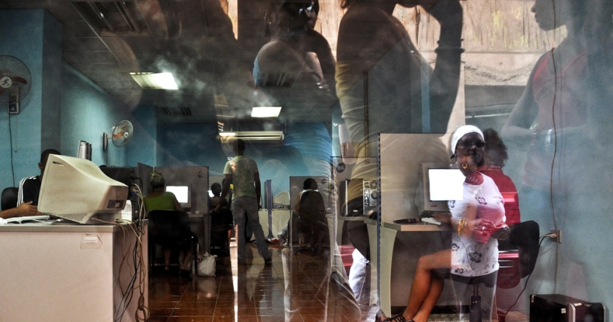Cubans waiting to use the internet are reflected on the window while others go online use in an internet cafe in Havana, on February 7, 2011. U.S. citizen Alan Gross was sentenced to 15 years in jail for attempting to set up a satellite dish to allow unfettered access to the internet for Cuba's small Jewish community.</p>