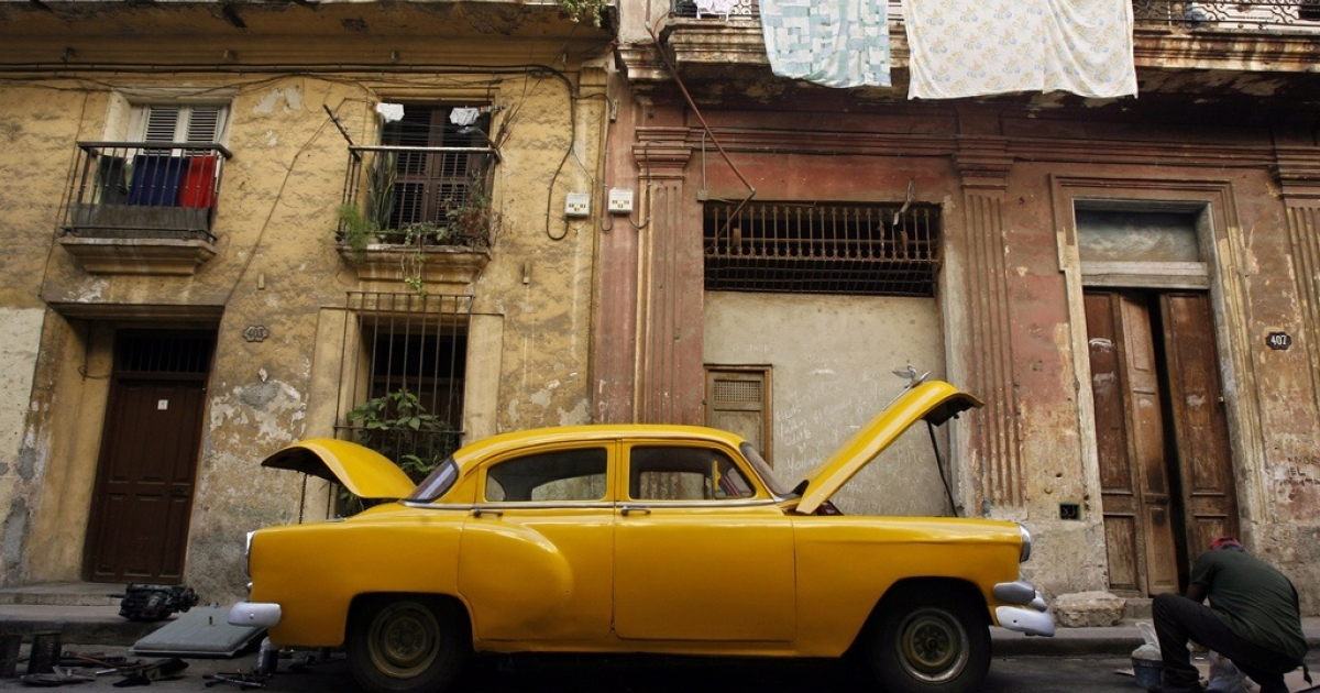 Making it work: Cubans repairing American cars have to improvise.</p>