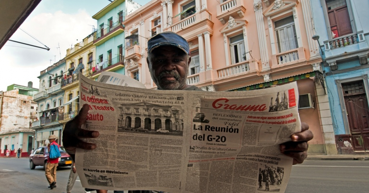 A Cuban reads the Granma newspaper announcing the new housing law, on Nov. 3, 2011 in Havana. The law allows citizens to buy and sell homes for the first time in 50 years.</p>