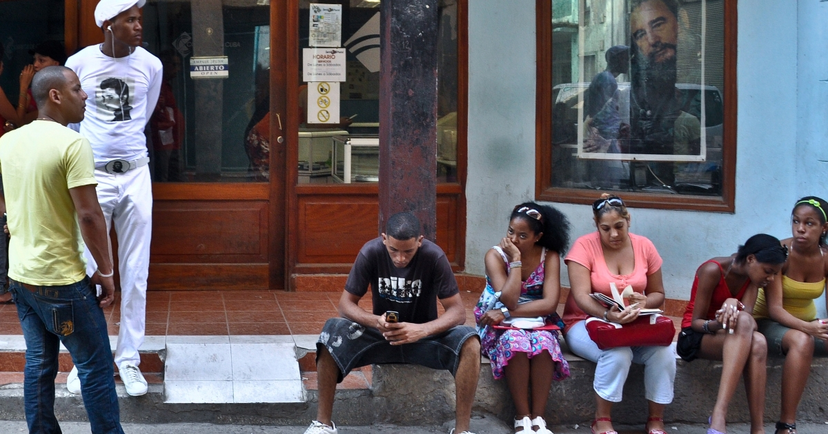 Cubans wait their turn outside an internet center in Havana.</p>