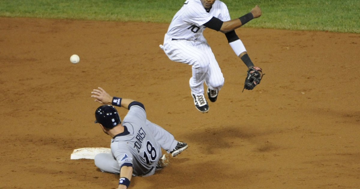 Alexei Ramirez, #10, of the Chicago White Sox forces out Ben Zobrist #18 of the Tampa Bay Rays in the third inning on Sept. 28, 2012, at U.S. Cellular Field in Chicago, Ill.</p>
