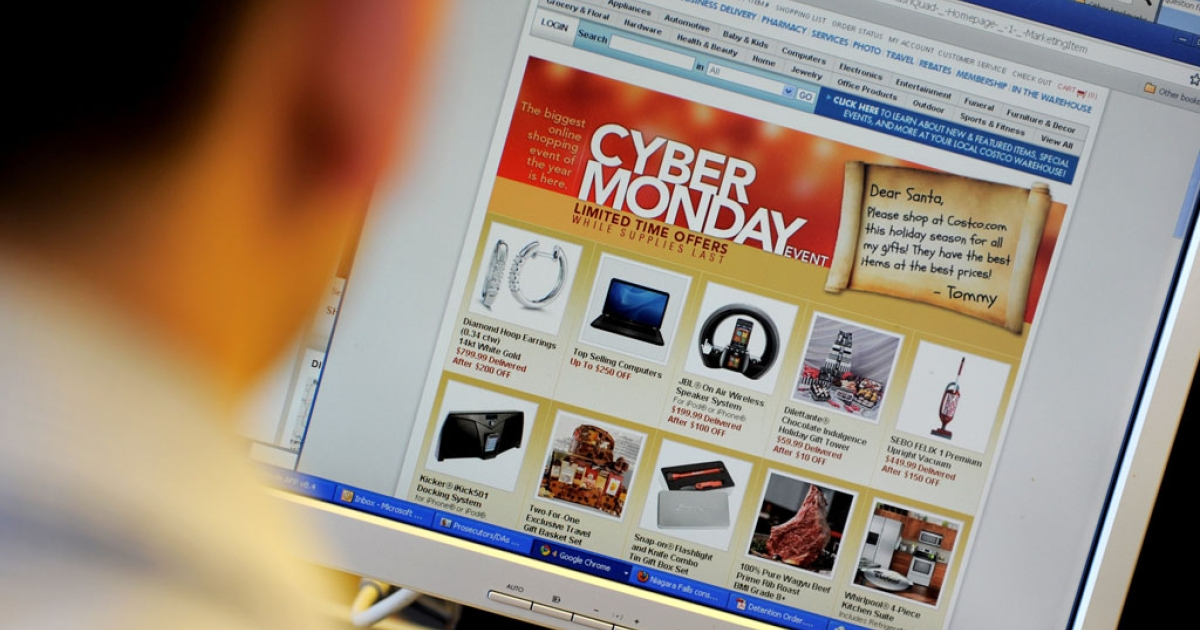 An office worker looks at Cyber Monday specials on the Costo website.</p>