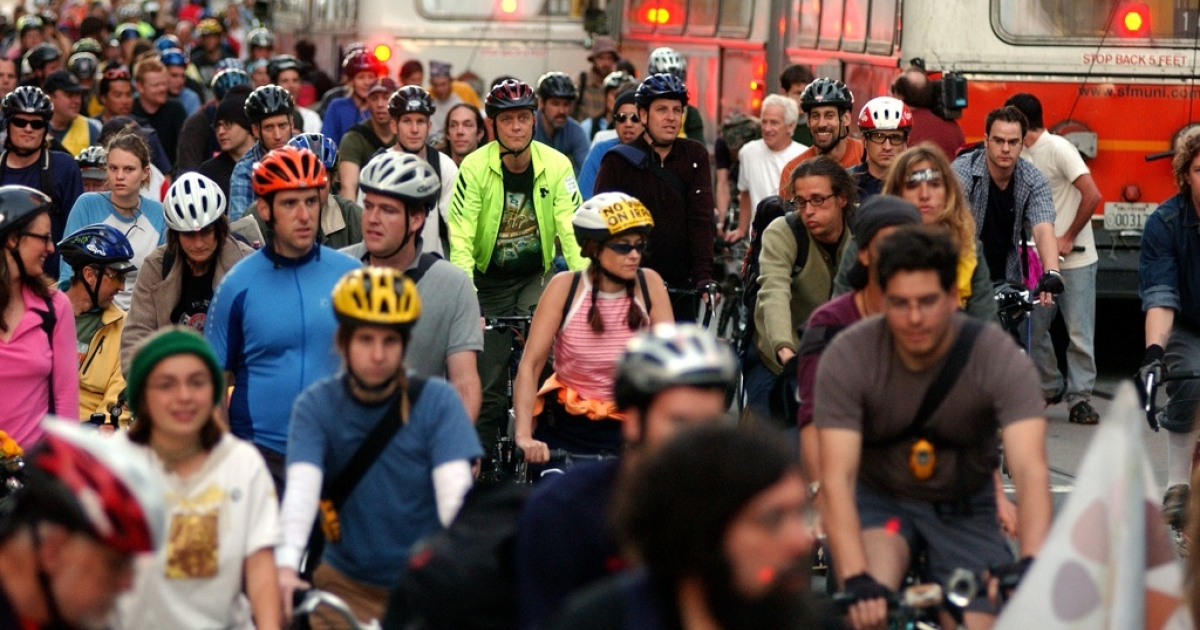 Bicycle riders participate in a 'Critical Mass' war protest in Justin Herman Plaza on March 28, 2003, in San Francisco, Calif.</p>