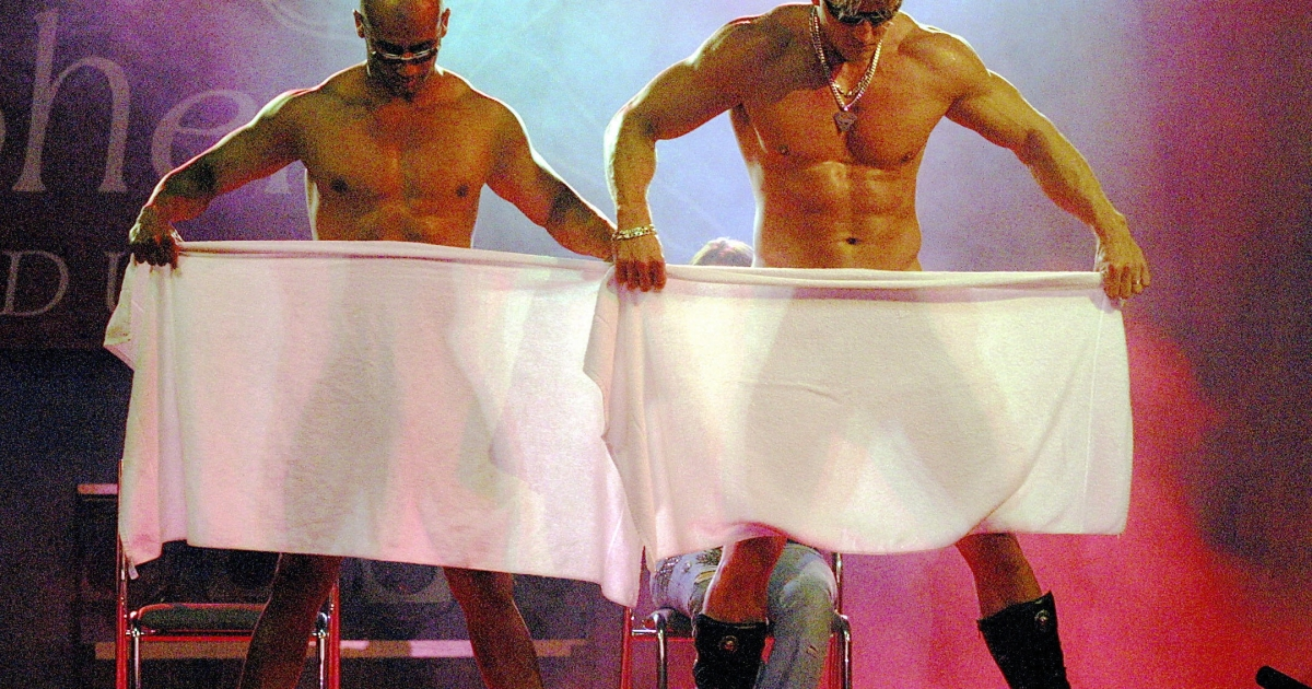 Two Czech male extras perform a 'Chippendale' erotic dance during a four-day erotic culture fair Erotica Sex 2004 at the Prague Exhibition Grounds.</p>