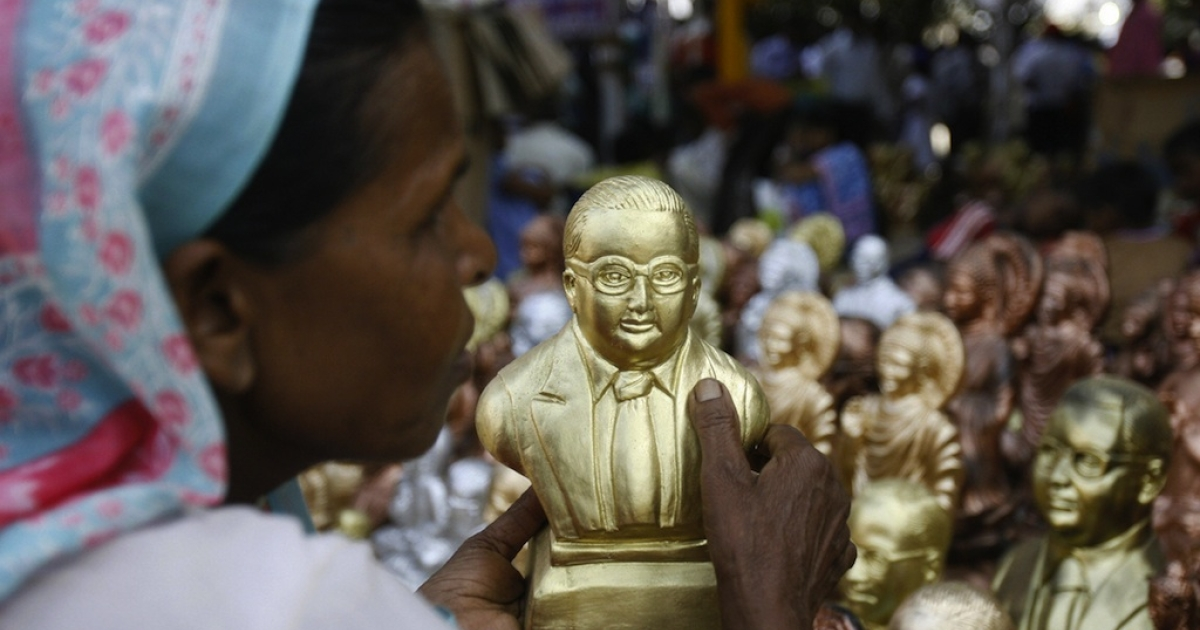 A dalit - low-caste or the oppressed - Hindu women buys a statue of B R Ambedka, a low-caste Hindu who fought against discrimination and who died over 50 years ago.</p>