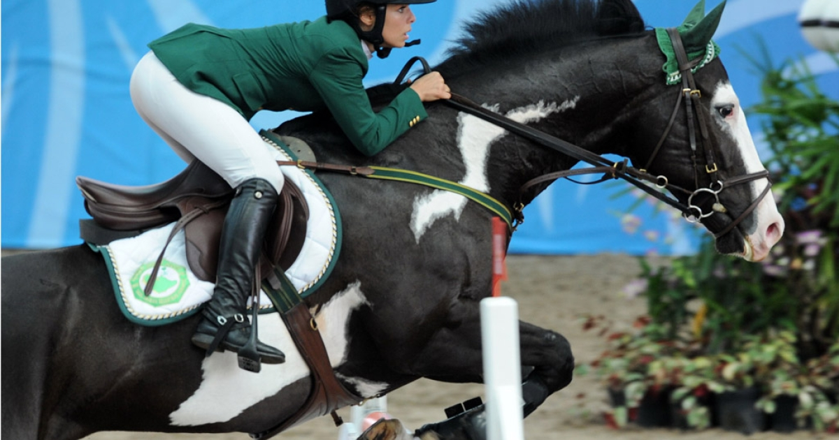 Saudi Dalma Rushdi Malhas rides Flash Top Hat at the Youth Olympic Games in Singapore on August 22, 2010.</p>