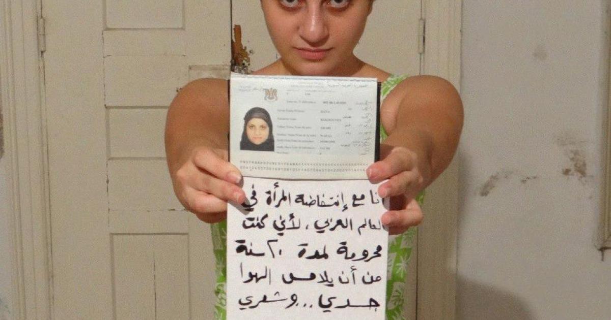 The controversial photo: Dana Bakdounes holding a sign reading: