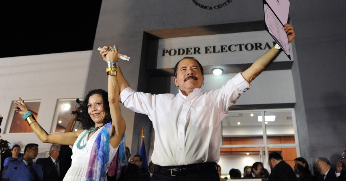 Nicaraguan President Daniel Ortega celebrates with First Lady Rosario Murillo after receiving his credentials in Managua Monday, a day before his re-inauguration.</p>