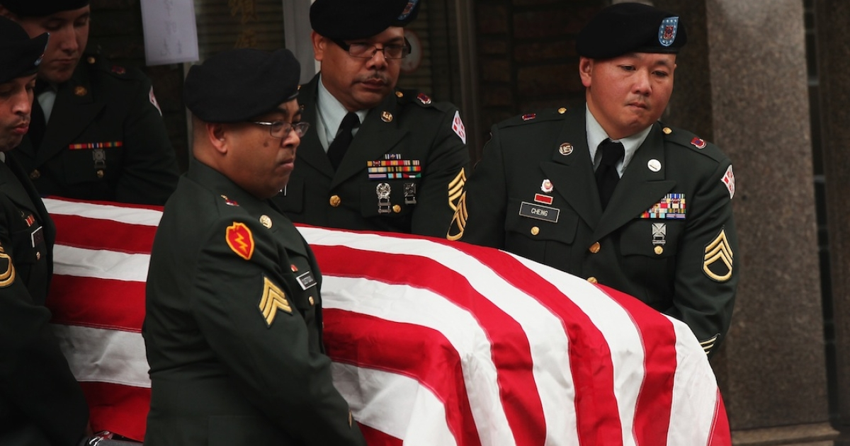 Soldiers carry the casket of Army Pvt. Danny Chen in Chinatown on October 13, 2011 in New York City.</p>