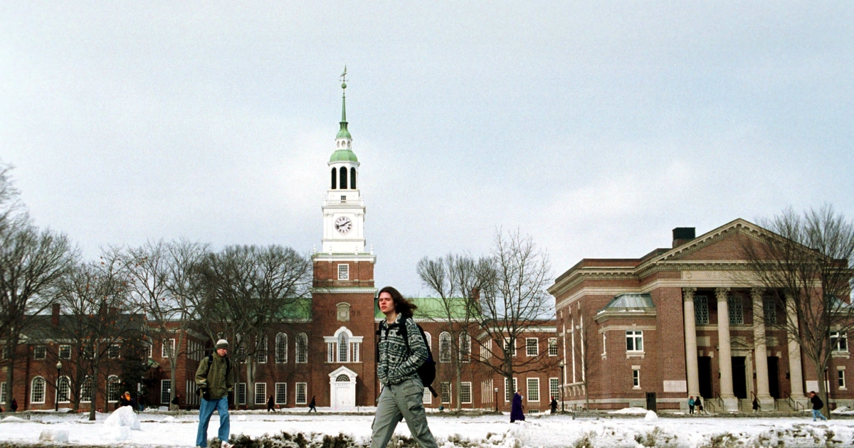 A student walks across the main campus of Dartmouth College in Hanover, NH.</p>