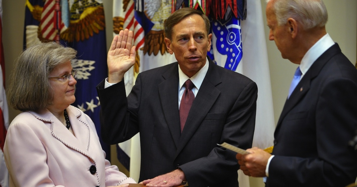 Holly Petraeus holds the Bible as her husband, retired General David Petraeus, takes the oath of office as the next director of the CIA from US Vice President Joe Biden on September 6, 2011.</p>