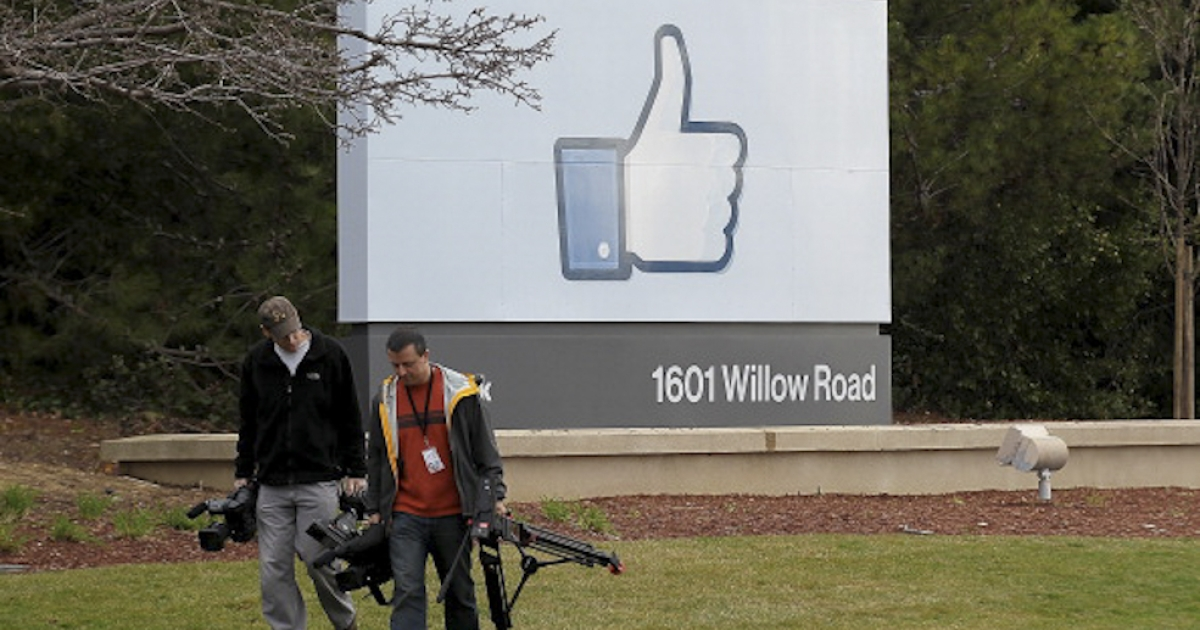 Television cameramen walk away from a sign standing in front of the Facebook headquarters on February 1, 2012 in Menlo Park, California. Facebook is expected to file for its first initial public offering, seeking to raise at least $5 billion. Graffiti artist David Choe, who painted murals on Facebook office walls in 2005 in exchange for shares, could rake in $200 million.</p>