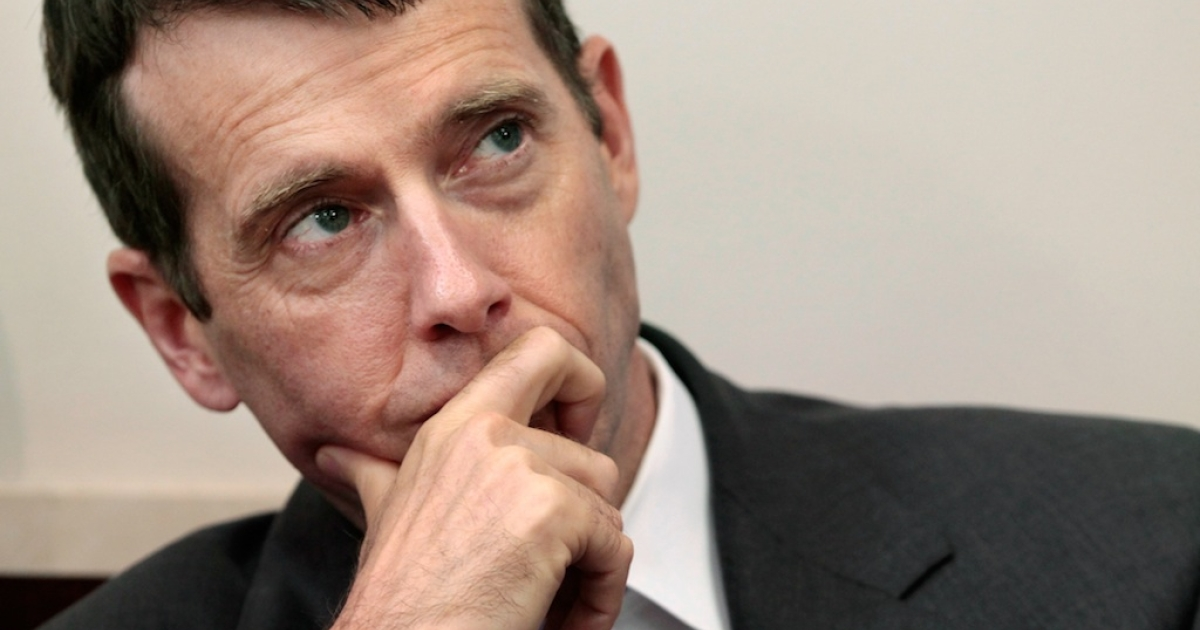 White House Senior Advisor David Plouffe listens to U.S. President Barack Obama during a news conference at the Brady Press Briefing Room at the White House July 11, 2011 in Washington, DC.</p>