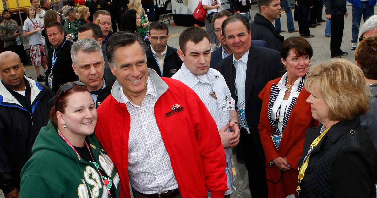 Republican presidential candidate Mitt Romney greets NASCAR fans in the garage area prior to the start of the NASCAR Sprint Cup Series Daytona 500 at Daytona International Speedway in Daytona Beach, Fla., on Feb. 26, 2012.</p>