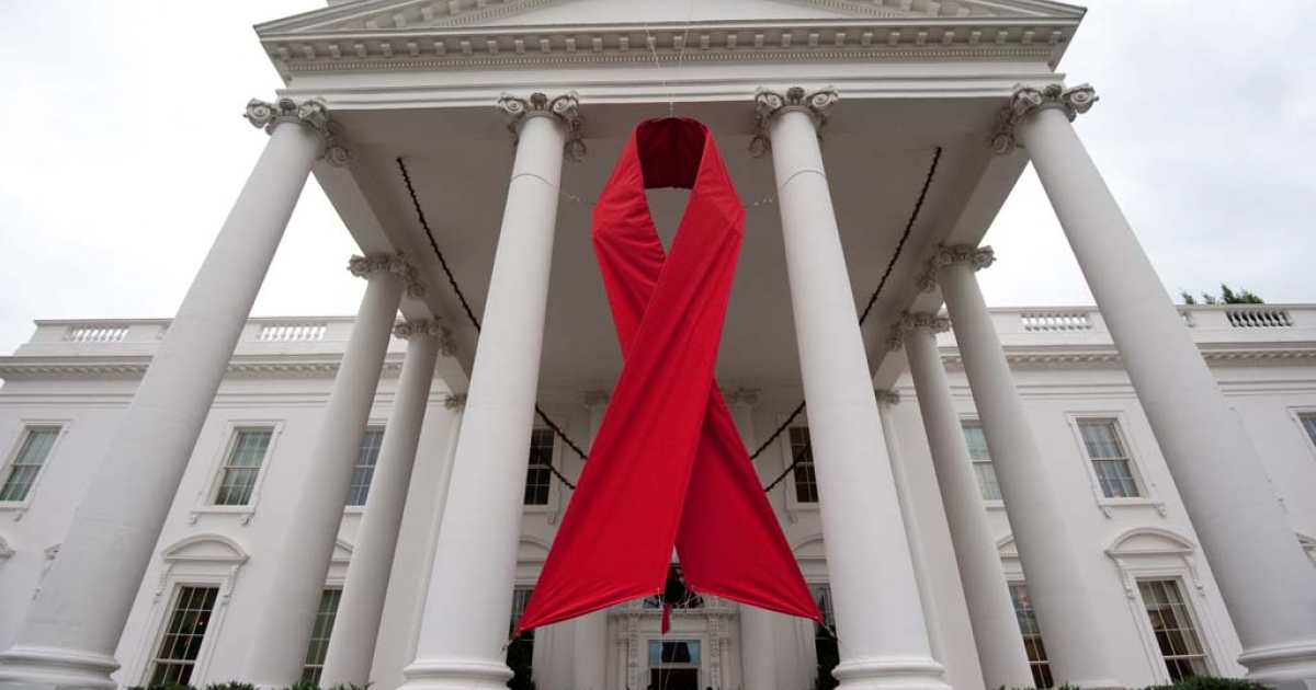 A large red ribbon hangs on the North Portico of the White House in Washington on November 30, 2010.</p>
