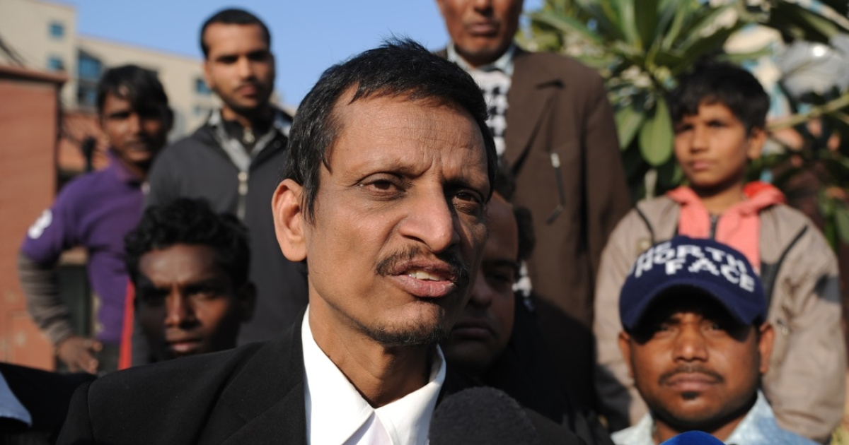 Indian lawyer M.L. Sharma, who represents two of the five adult defendants on trial for the gang-rape of a student, speaks with the media outside the Saket District Court in New Delhi on Jan. 10, 2013.</p>