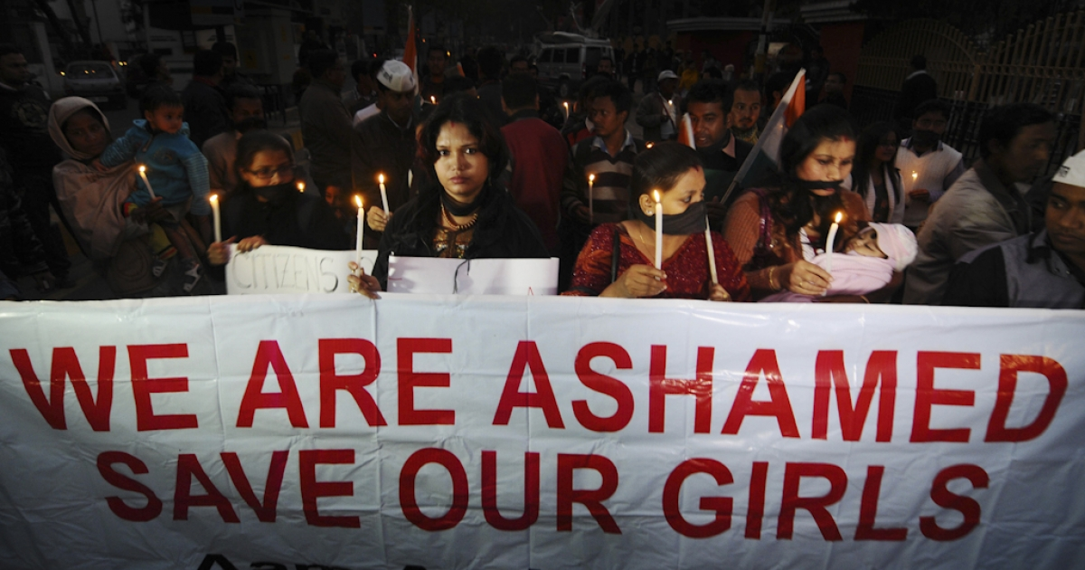 Indian protestors march behind a banner as they take part in a candlelight procession in Guwahati on December 29, 2012, after the death of a gang rape victim from the Indian capital New Delhi. Indian leaders appealed for calm and security forces headed off fresh unrest by turning New Delhi into a fortress after a student who was savagely gang-raped died in a Singapore hospital. Police threw a ring of steel around the centre of the Indian capital after news of the 23-year-old medical student's death was broken in the early hours by the Singapore hospital that had been treating her for the last two days.</p>