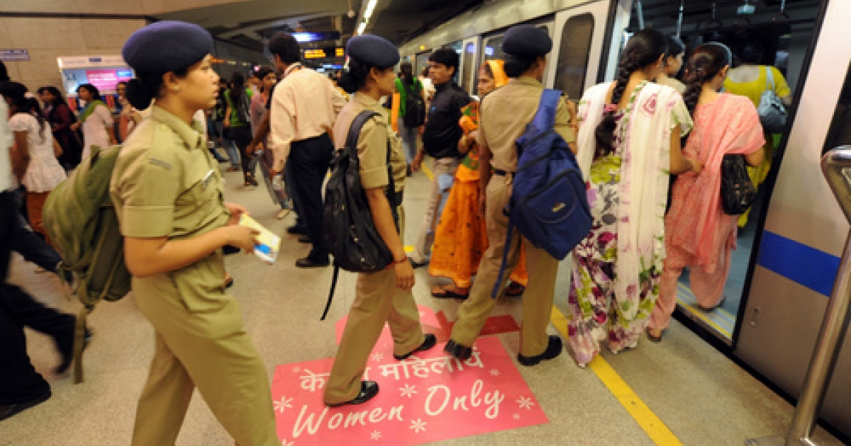 Female commuters board a women-only coach at a Delhi Metro train station in New Delhi on October 2, 2010.</p>
