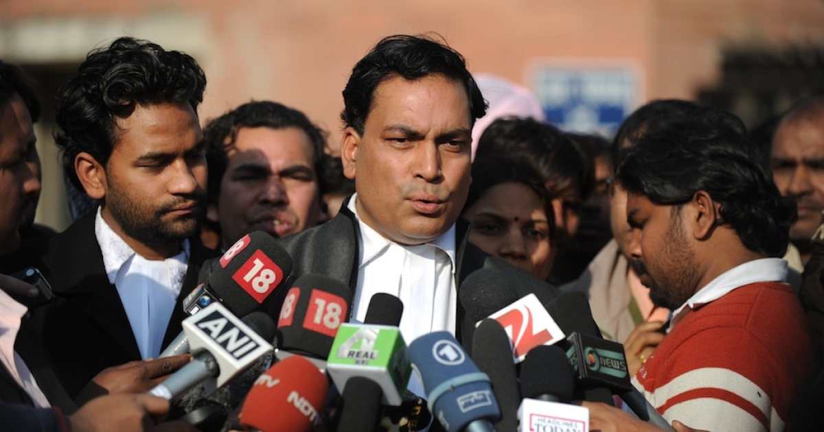 Indian lawyer Ajay Prakash Singh (C), who represents defendants Akshay Thakur and Vinay Sharma who are on trial for the gang-rape of a student, speaks with the media outside the Saket District Court in New Delhi on January 10 ,2013. A lawyer for the defendants in the New Delhi gang-rape case accused police on January 10 of beating confessions out of them as they appeared for their second court appearance.</p>