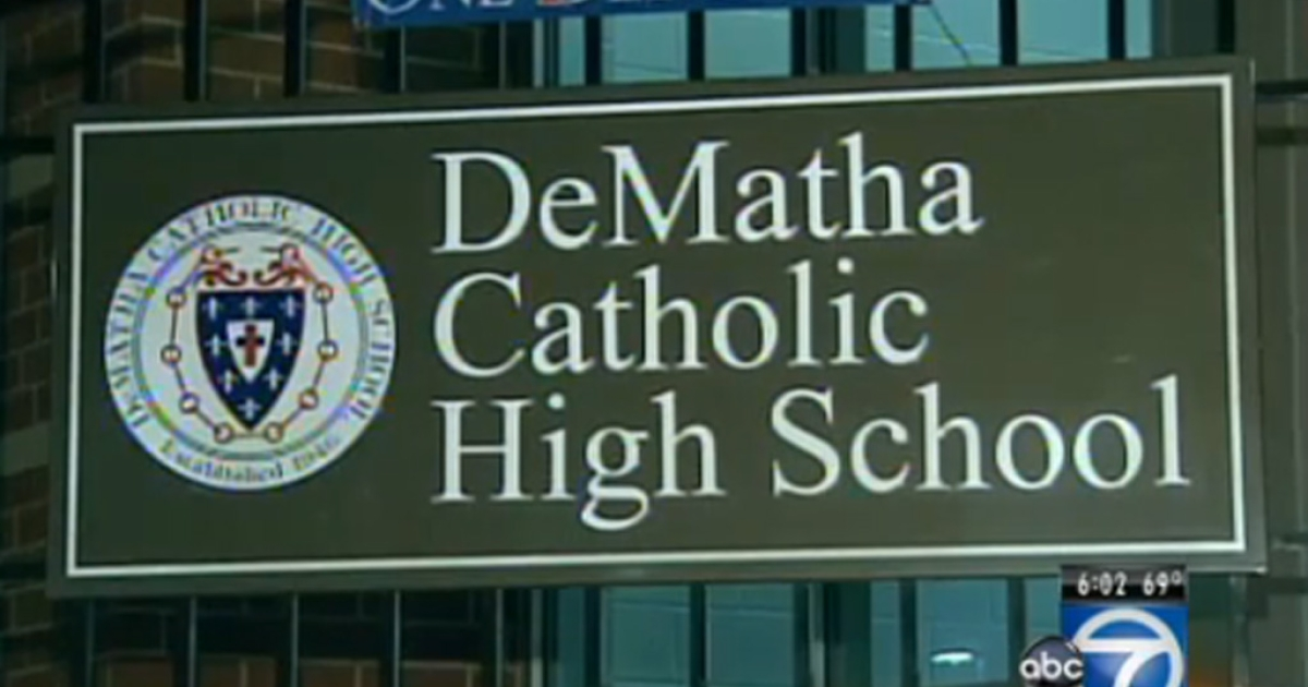 DeMatha Catholic High School principal Daniel McMahon says he's standing behind his coach, staff and football team after five players became embroiled in a sex scandal.</p>