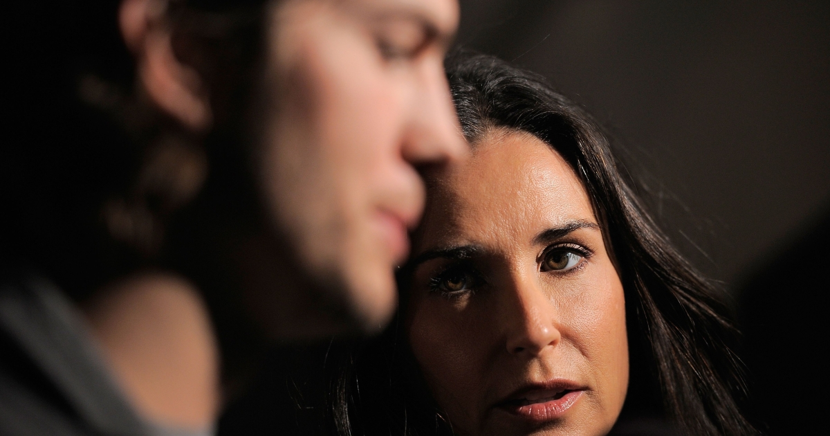 Actors Ashton Kutcher and Demi Moore speak to the media at the launch party for