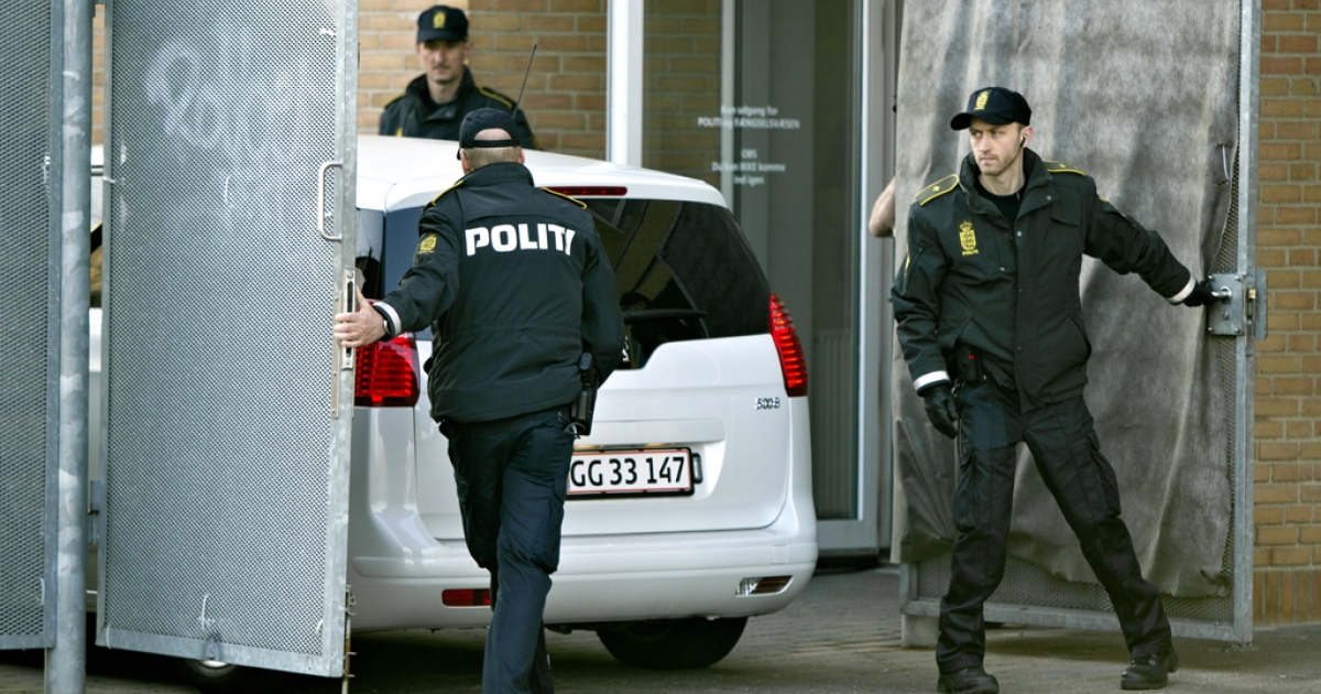 Terror suspects arrive on April 13, 2012 in a police car at the Glostrup courthouse in Copenhagen for their trial over a suspected plot to massacre the staff of a newspaper that first published controversial cartoons of the Prophet Mohammed. Police announced on April 27, 2012 that three others were arrested in a separate terror plot.</p>