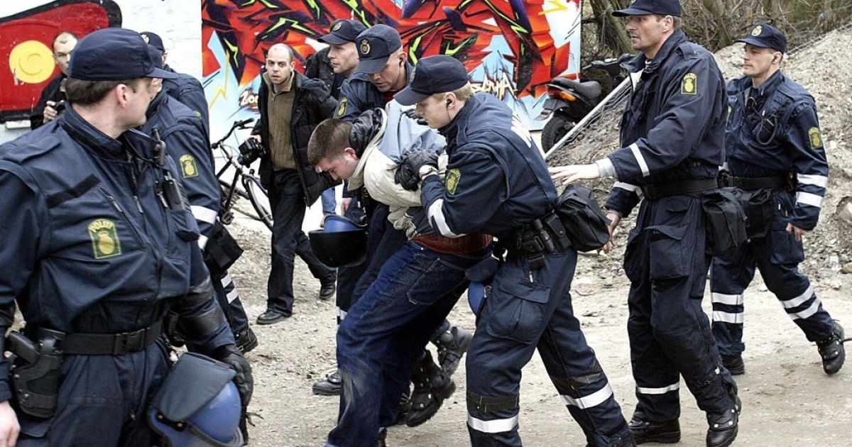 Danish police arrest an unidentified person in a raid in Copenhagen's Free City, Christiania, in 2004 in a final attempt to close down the world famous Pusher Street. These days, the city is taking an increasingly libertarian approach.</p>