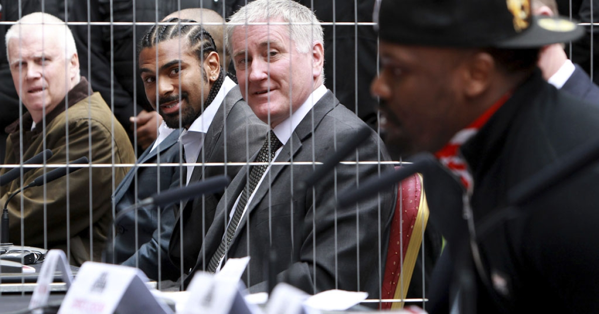 David Haye, second from left, and Dereck Chisora speak to reporters from opposite sides of a fence during a press conference Tuesday to announce their July 14 fight in London, England.</p>