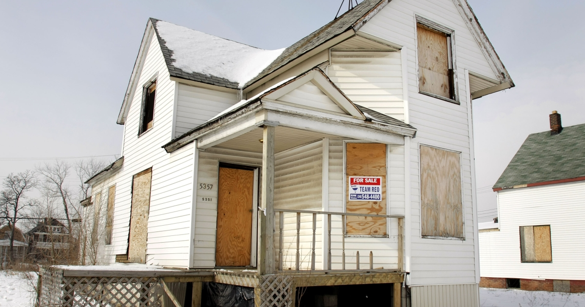 A boarded up house sits for sale Feb. 14, 2008 in Detroit, Michigan.</p>