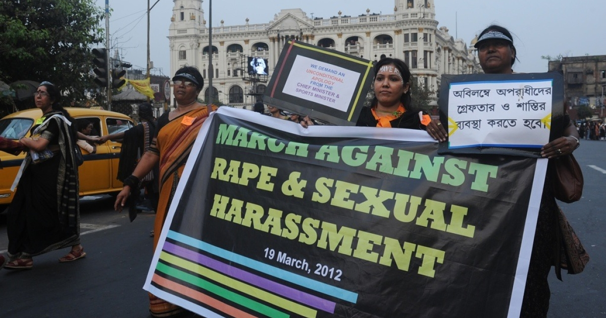 Women's rights activists hold a banner as they march during a rally in Kolkata, India on March 19, 2012. The rally was organized to protest against the recent physical assaults and rape on women, and also as a demand for a proper rule of law for women's rights.</p>