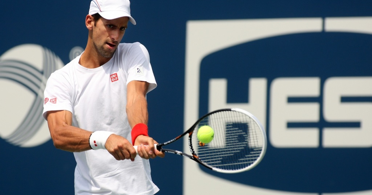 Novak Djokovic hits a shot while practicing before to the start of the 2012 U.S. Open at the USTA Billie Jean King National Tennis Center on Aug. 24, 2012, in Queens.</p>