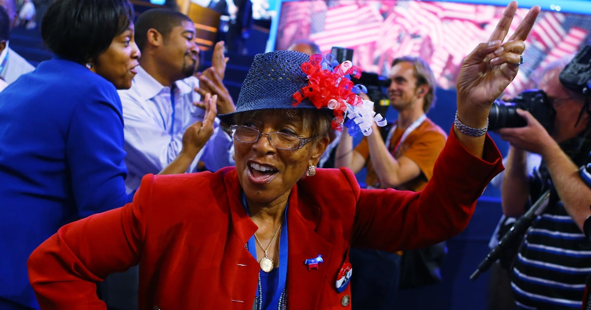 Day two of the Democratic National Convention: People dance to music at the Time Warner Cable Arena on September 5, 2012 in Charlotte, North Carolina. The DNC, which runs through September 7, will nominate US President Barack Obama as the Democratic presidential candidate.</p>