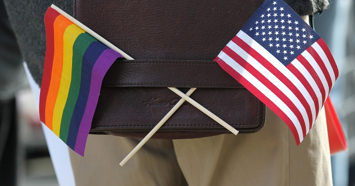 A gay pride and an American flag hang from a shoulder bag during a demonstration. Minnesota became the 12th state to legalize gay marriage on May 13, 2013, and only the second in the Midwest.</p>