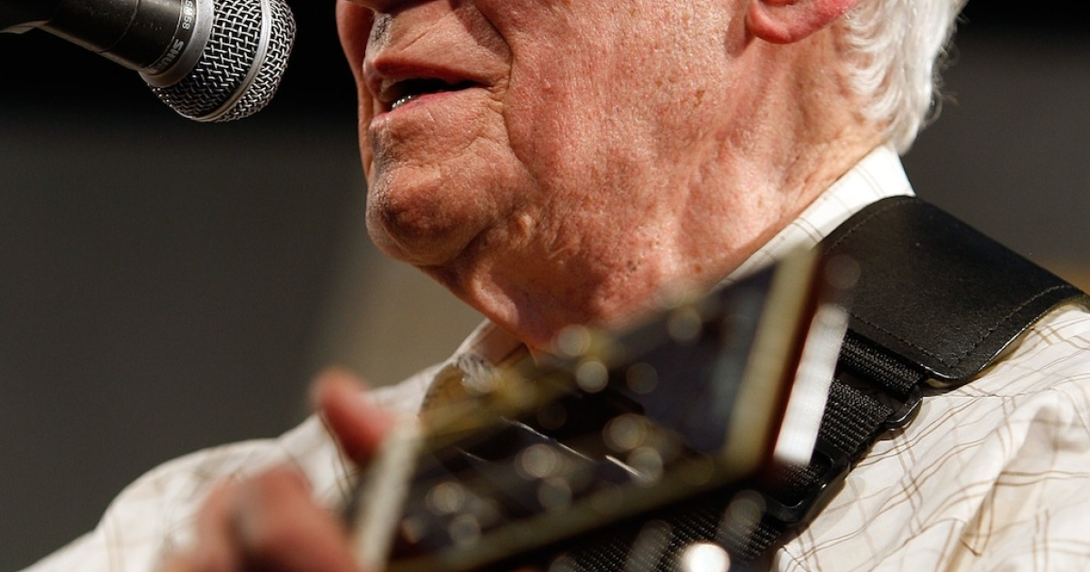 Doc Watson performs in the Blues Tent in the 2009 New Orleans Jazz &amp; Heritage Festival at the Fair Grounds Race Course on May 1, 2009 in New Orleans.</p>